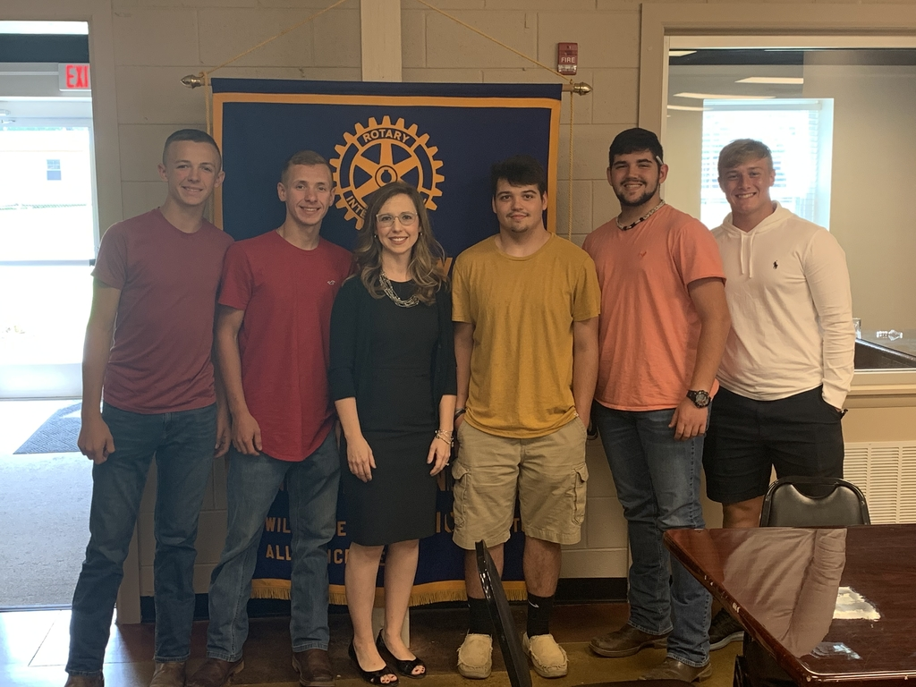 Rotary President Elaine DeSario with LC/ACTC Electricity Partnership students.